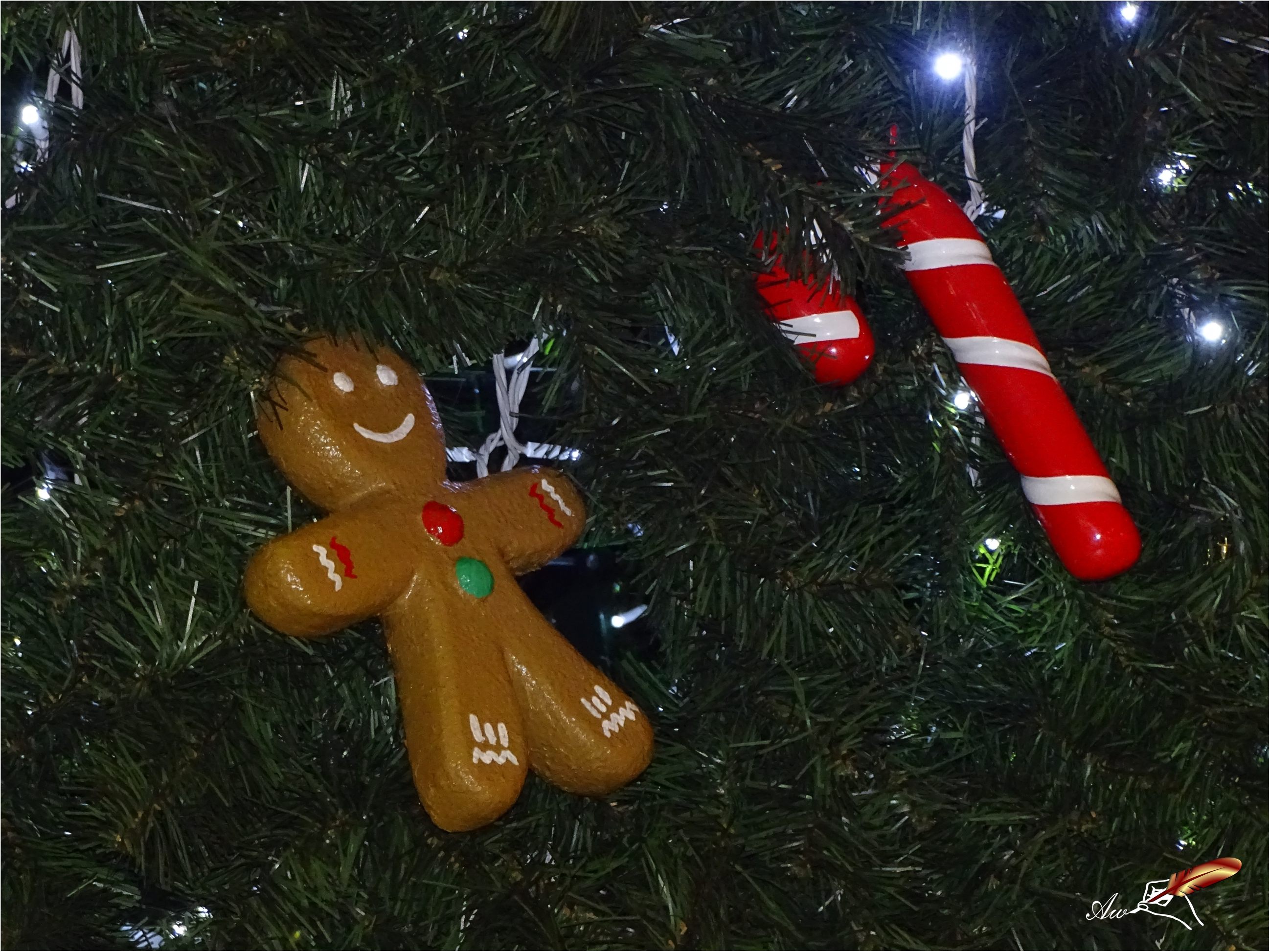 Gingerbread man and candy cane in Christmas tree - by Andrada Anitei