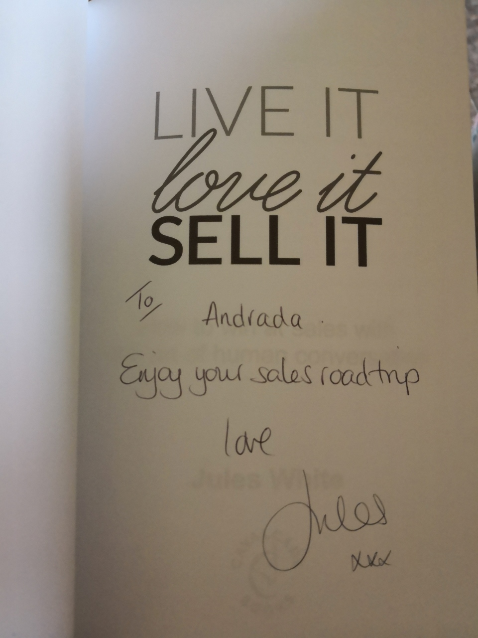 """Live it, Love it, Sell it"" front page with author's signature"